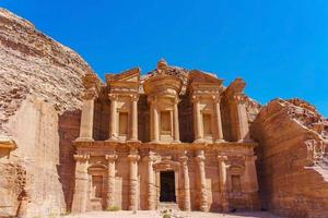 Famous facade of the Ad Deir in the ancient city of Petra, Jordan