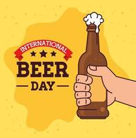 International beer day celebration with hand holding a beer bottle vector