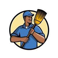 African American street cleaner holding broom retro