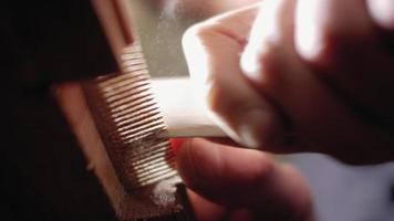 Hand Sanding a Wooden Comb video