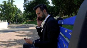 Man Using a Mobile Phone on A Bench