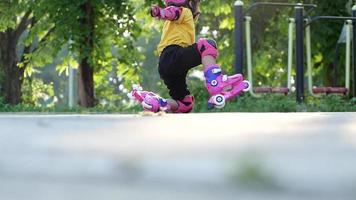 Little Girl Learning to Roller Skate in The Park