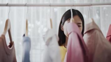 Woman Choosing Clothes For Shopping