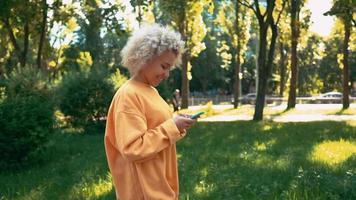 Side view blonde woman scrolls news feed outdoors video