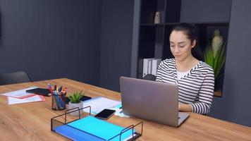 Businesswoman Working on A Laptop in A Modern Office video