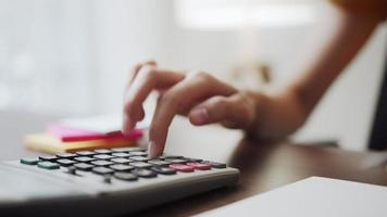 Hand close up Calculating Income Expenses video