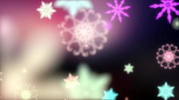 bunte Schneeflocken der Weihnachtsschleife unkonzentriertes Bokeh-Licht