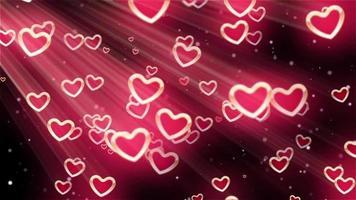Corazones rosas estallando en fondo negro video