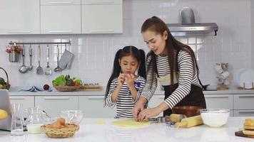 Mother And Daughter Happily Bake Desserts In The Kitchen.