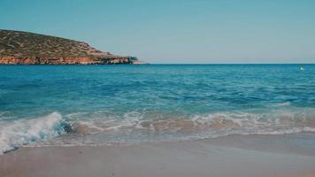 Ibiza Cala Bassa Beach Washed by the Clear Waves