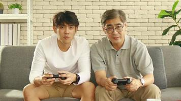 Father And Son Having Fun With Video Games