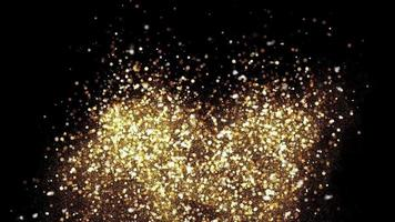 Gold shimmering particle on black background for celebration.