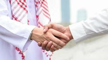 Parallax Arabic and businessman shaking hand video