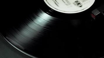 Dark vinyl record spinning