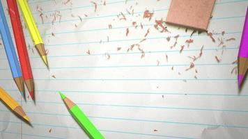 lápices de colores y goma de borrar sobre papel