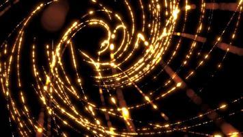 Luzes douradas do bokeh formando espirais girando no espaço