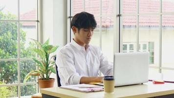 Young Businessman Sitting At Work With Stress video