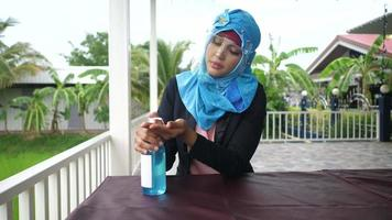 Muslim woman clean hands by alcohol gel video