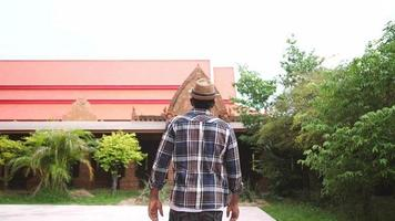 African Male Tourist Walking Towards Asian Temple. video