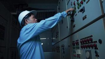An Asian Senior Computer Engineer Checking on Computer Server in Data Center Room