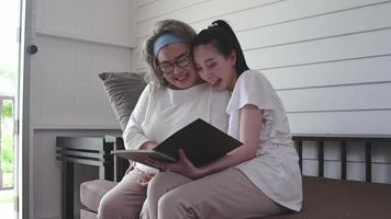 Senior Mother and Daughter Reading a Book