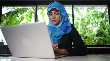 Young Arab businesswoman working on computer at home video