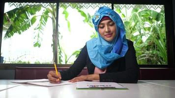 Business muslim woman checking finance report  video