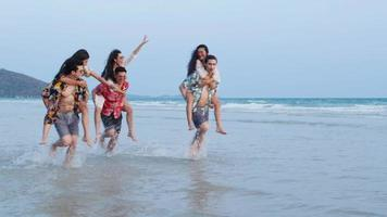 Asian teenage boys and girls happy running at seaside.