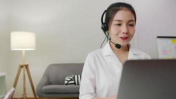 Businesswoman wearing microphone headset.