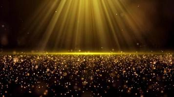 Light shining on gold dust particles video