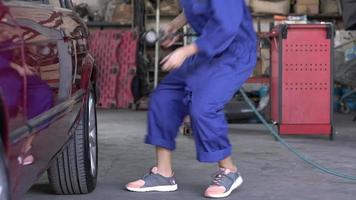 Woman Technician Checking Car Tire Air Pressure  video