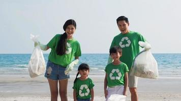 Asian family Volunteer for Trash Pick up at Beach.