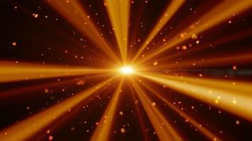 partículas de ouro e fogo em feixes de luz. video