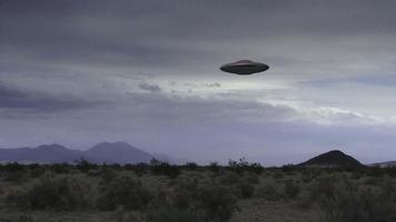 A UFO Hovers Over A Desert