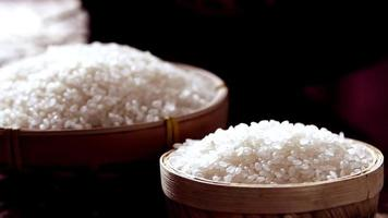 Japanese Rice Grains Pouring Into Wooden Bowl