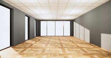 parede de cor cinza e piso de madeira em uma grande sala