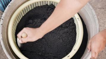 Mixing of soil in the basket. video