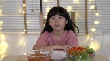 Asian kid girl unhappy during family time at home