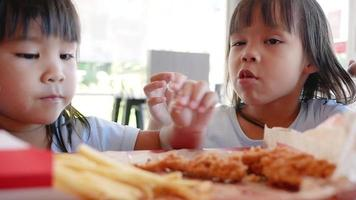 Sisters Eating Fried Chicken and French Fries