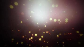 bucle de partículas mágicas de brillo con luz de destello bokeh video
