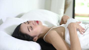 Asian Young Woman Sleep in Bed