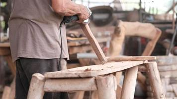 Craftsman Working on An Ax Handle