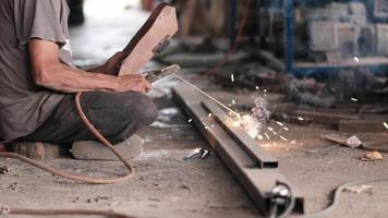 Slow motion scene of welder working with steel
