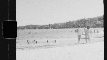 Super 8 Black and White - A couple walking on the beach video