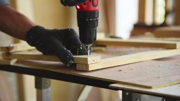 Carpenter Using an Electric Hand Drill to Nail a Wood Plank video