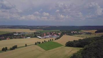 Drone Flying Towards a Village in 4 K