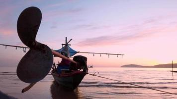 Fishing boat rests on beach. video