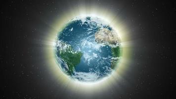 la luz envuelve la tierra en el espacio