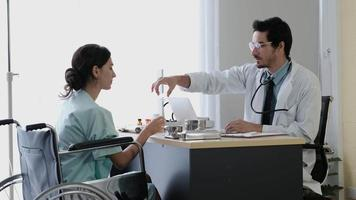 Doctor prescribes some medicine and discusses it with the patient