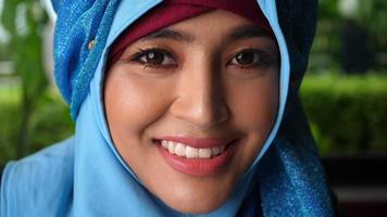 Close up Portrait of muslim business woman smiling look at camera video